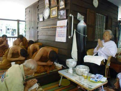 Thai monks receive blessing from Khun Mae Jundee.jpg